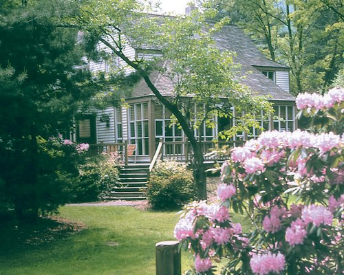 Shawnee Village Resort villa surrounded by trees and flowering shrubs.