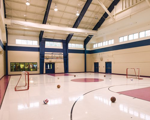 An indoor basketball court with a hockey setup.