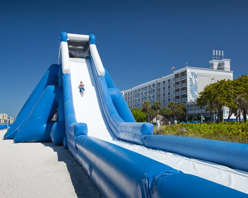 A resort with a large inflatable water slide.