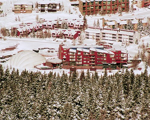 An aerial view of Vail Run Resort surrounded by snow covered woods.