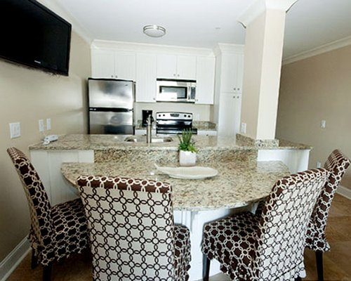 A furnished kitchen with dinning for four.