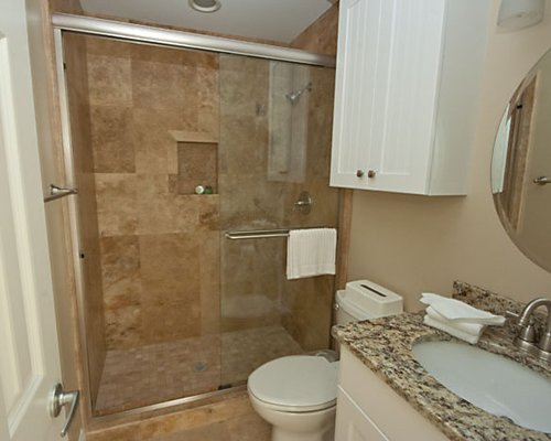A bathroom with stand-up shower.