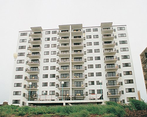 Multiple high-rise units with private balconies.