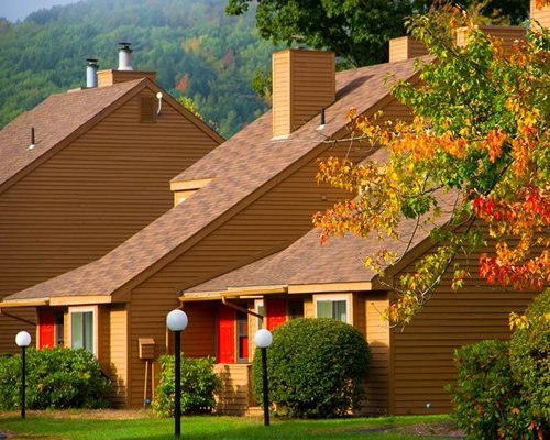 Vacation homes surrounded by trees in fall.