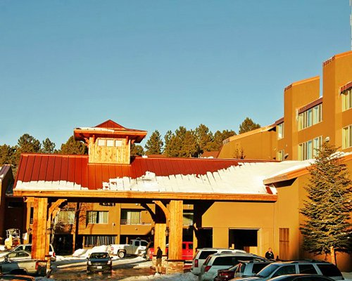 An exterior view of the Commons resort alongside a parking area.