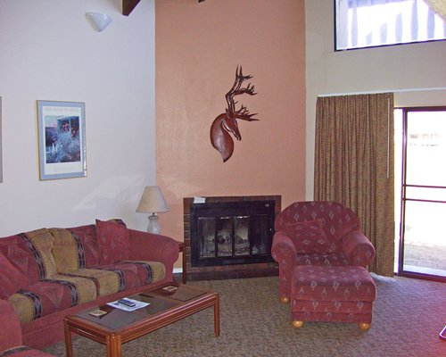 A furnished living room with pullout sofa and fireplace.