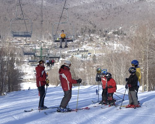 Group of skiers on the mountain below the ski lift..