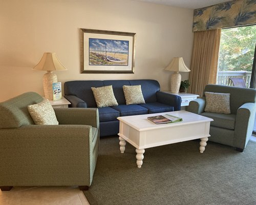 A well furnished living room with lagoon access.