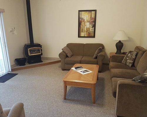 Furnished living room with a television and fireplace.