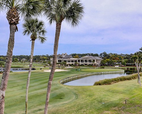 View of family cycling on a pathway.