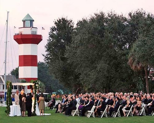Scenic view of a wedding ceremony beside a lighthouse at Sea Pines Plantation.