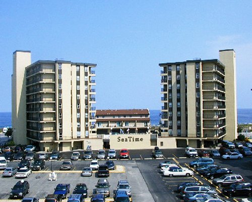 Exterior view of Sea Time resort with car parking.