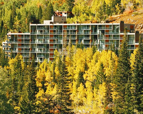 Scenic exterior view of Iron Blosam Lodge with multiple unit balconies.