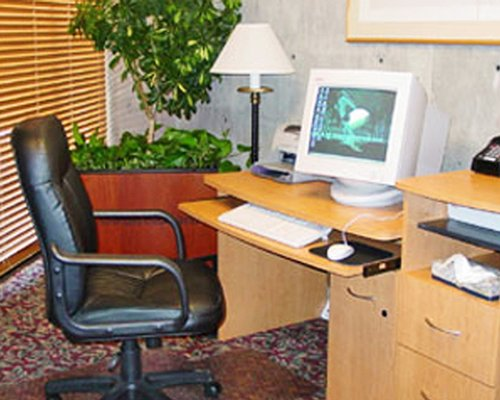 A computer with table and chair.