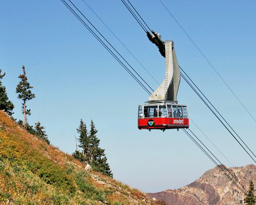 View of cable car surrounded by mountain.