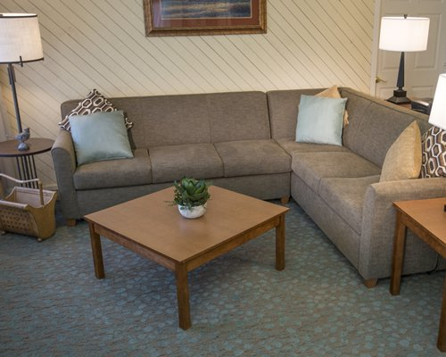 A furnished living room with double pull out sofa.
