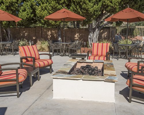 A view of patio furniture with campfire pit.