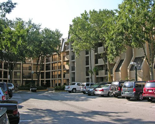 Exterior view of the condos at Island Club-Seawatch with car parking.