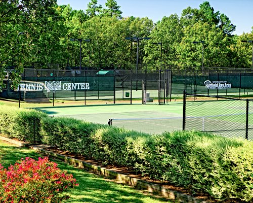 Scenic outdoor recreation area with a tennis court.
