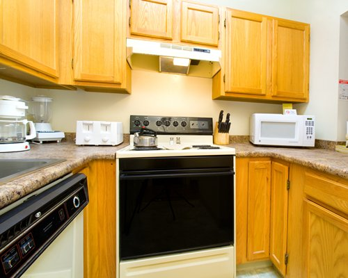 Kitchen with stove and microwave.