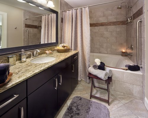 A bathroom with a shower and bathtub.