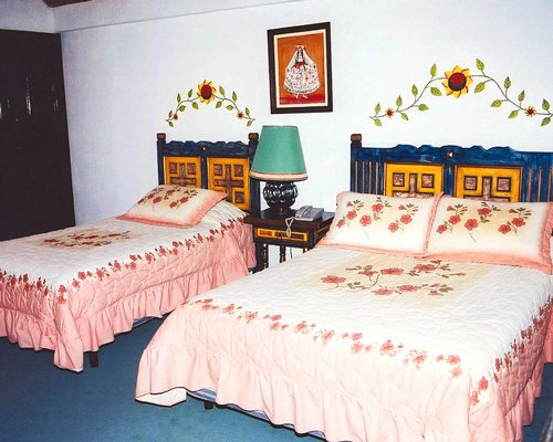 A well furnished bedroom with a twin bed and a king bed.