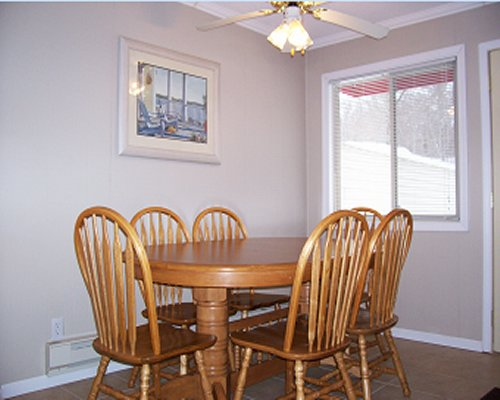 Six seated colonial style dining area.