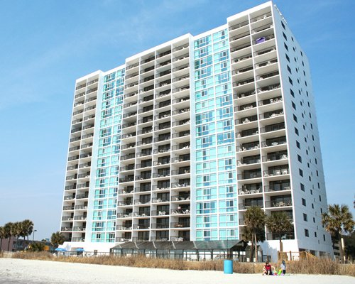 Exterior view of multiple unit balconies at Palmetto Beach Club.