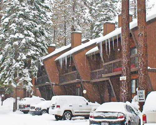 Snow covered Club Tahoe resort and parking.