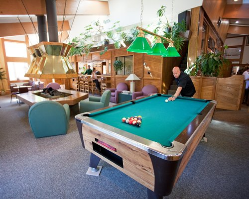An indoor recreational area with a pool table.