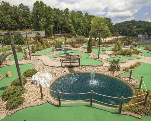 A putt putt course with a fountain.