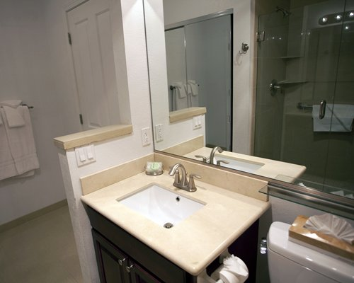 A bathroom with an open sink vanity.