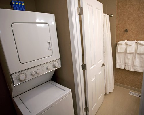 A bathroom with a washing machine.