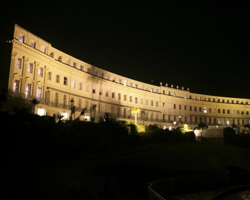 Scenic exterior view of The Osborne Club at night.