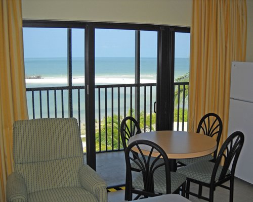An open plan unit with a dining area balcony and beach view.
