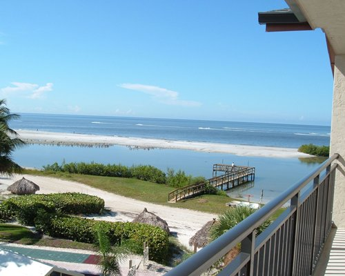 A view of the ocean and sandbar from the balcony of a resort unit.