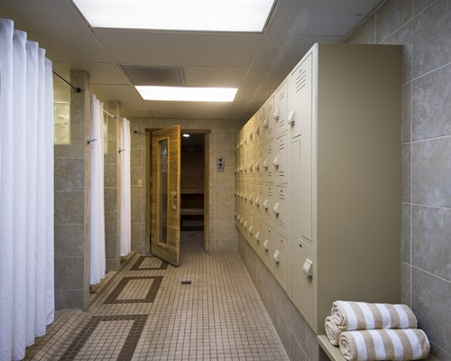 A bathroom with a combination of dress lockers and showers.