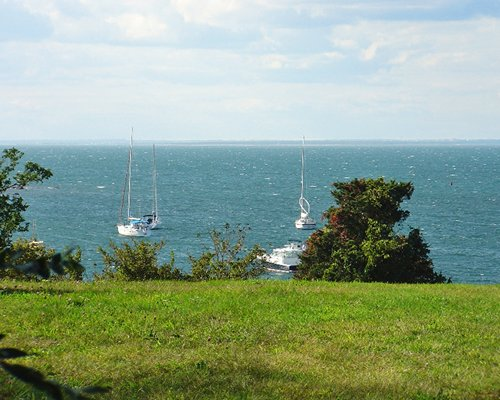 A scenic view with sail boats.