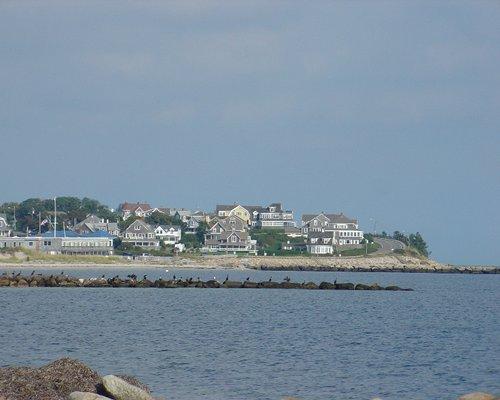 View of buildings alongside ocean.
