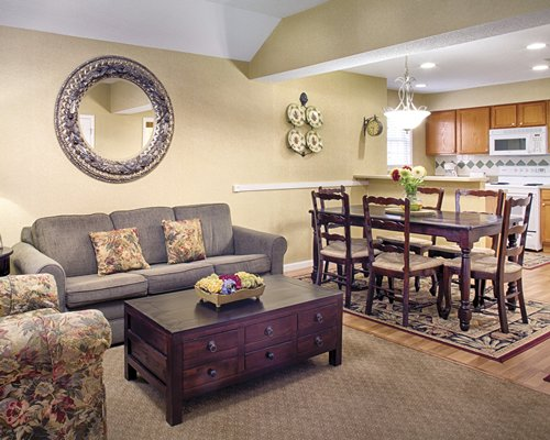 An open plan living room dining room and kitchen area.