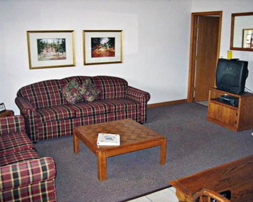 Furnished living room with television.