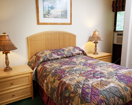 A well furnished bedroom with a queen size bed.