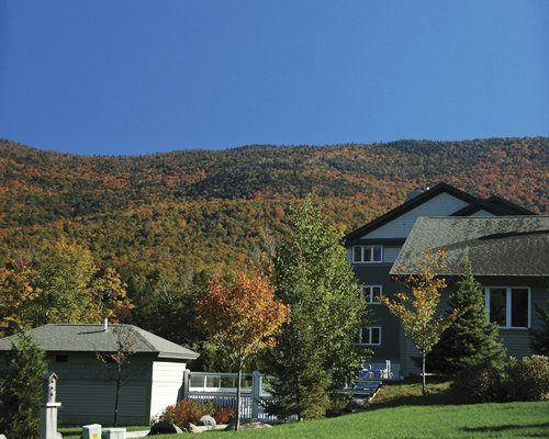 Scenic exterior view of multiple condo balconies at Smugglers Notch Resort.