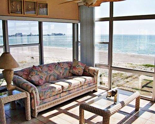 A furnished living room alongside the ocean.