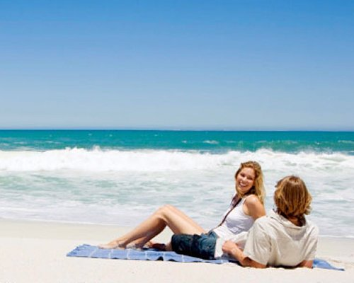A couple sitting on the beach.