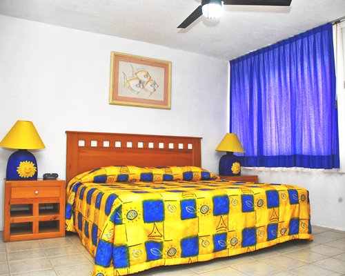 A well furnished bed room with king size bed.