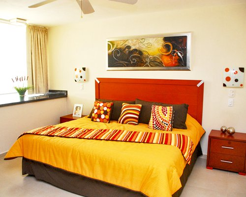 A well furnished bedroom with a king sized bed and an outdoor view.