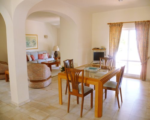A well furnished living and dining area with an outdoor view.