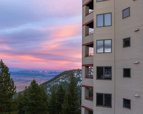 A dusk view of Ridge Tahoe resort in a wooded area.
