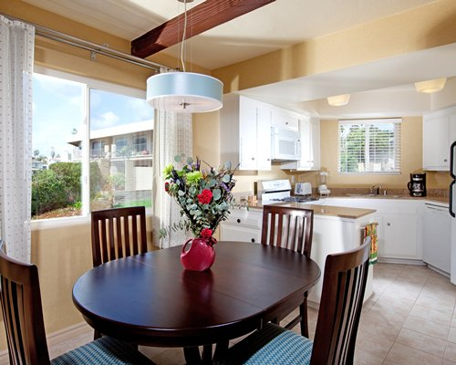 An open plan dining and kitchen area with a landscape view.